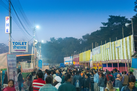 BABUGHAT, KOLKATA, WEST BENGAL  INDIA - 9TH JANUARY 2018 : Transit camp for Gangasagar for Makar Sankranti (Holy bathing at river Ganges). Shot agsint colored light and holy smoke.