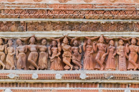 Terracotta decorations on the walls at Pratapeswar Temple at Kalna, West Bengal, India. Terracotta is a brownish-red clay that has been baked and is used for making things. Stock Photo