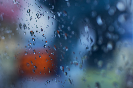 Raindrops falling on glass, abstract blurs - monsoon stock image of Kolkata (formerly Calcutta) city , West Bengal, India Stock Photo