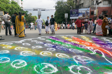 KOLKATA, WEST BENGAL , INDIA - JUNE 25TH 2017 : Devotees coloured road on Rath Yatra festival. God Jagannath, Balaram and Goddess Suvadra are taken for a chariot ride on this auspicious day. Editorial
