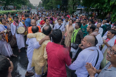 KOLKATA, WEST BENGAL , INDIA - JUNE 25TH 2017 : Devotees dancing spiritually on Rath yatra fetival in Kolkata city. God Jagannath, Balaram and Goddess Suvadra are taken outside of temples for a chariot ride in city.