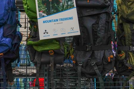 ULUBERIA, HOWRAH, WEST BENGAL / INDIA - 18TH MARCH 2018 : Colorful mountaineering bags are on display at Dechathlon S.A. store , world's largest sporting goods retailer. Editorial stock image.