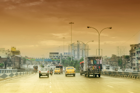 HOWRAH, WEST BENGAL , INDIA - AUGUST 7TH 2016 : Vidyasagar Setu (Bridge) over river Ganges, known as 2nd Hooghly Bridge in Kolkata,West Bengal,India. Connects Howrah and Kolkata, Orange afternoon sky in background