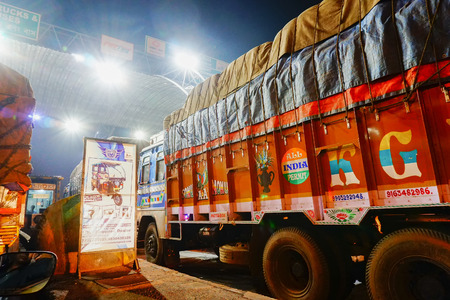 DHULAGORI , HOWRAH, WEST BENGAL  INDIA - 18TH MARCH 2018 : Various trucks are waiting in que to cross Toll Plaza at Dhulagori . Shot at night - editorial stock image.