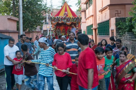HOWRAH, WEST BENGAL , INDIA - JULY 14TH 2018 : Devotees dragging ropes of Rath (chariot) of God Jagannath, Balaram and Goddess Suvadra as ritual. rath jatra festival.