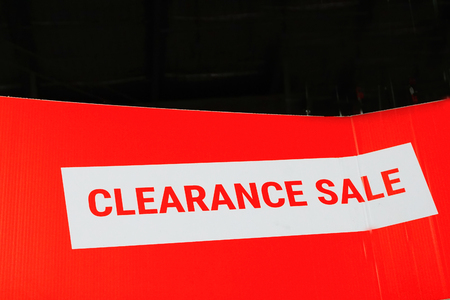 Sales promotional offer for customers - stating clearance sale of goods and services - RF stock image with black background for copyspace