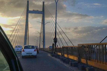 HOWRAH, WEST BENGAL , INDIA - JULY 8TH 2018 : Vidyasagar Setu (Bridge) over river Ganges, 2nd Hooghly Bridge. Connects Howrah and Kolkata, Longest Cable - stayed bridge in India. Dramatic sky.