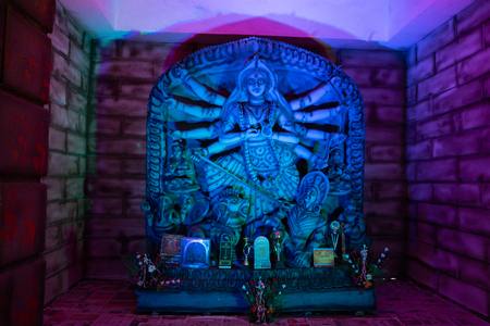 Colour of Goddess Durga idol at decorated Durga Puja pandal, shot at colored light, at Kolkata, West Bengal, India. Durga Puja is biggest religious festival of Hinduism. Editorial