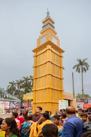 KOLKATA , INDIA - SEPTEMBER 29, 2017 : Decorated Durga Puja pandal - replica of London Big Ben watch of England , at Kolkata, West Bengal, India. Biggest religious festival of Hinduism.
