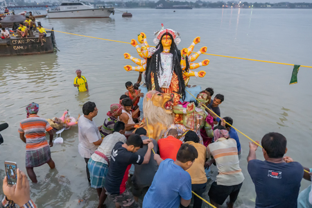 KOLKATA, WEST BENGAL, INDIA - 30 SEPTEMBER 2017: Idol of Goddess Durga is being carried to holy river ganges for immersion, called