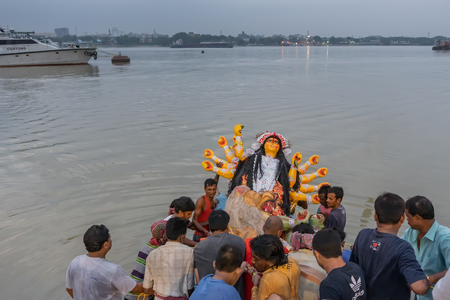 KOLKATA, WEST BENGAL, INDIA - 30 SEPTEMBER 2017: Idol of Goddess Durga is being carried to holy river ganges for immersion, called 写真素材 - 110720442
