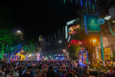 KOLKATA, WEST BENGAL, INDIA - DECEMBER 25TH 2017 : Beautiful decorated lighting of Merry Christmas at night at Park Street, Kolkata. People celebrating Merry Christmas.