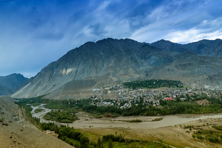 Top view of Indus river and Kargil City with Himalayan mountains in background, at Jammu and Kashmir, India. Kargil was the war zone of India Pakistan war in 1999. India won the war against Pakistan. Stock Photo - 118626617