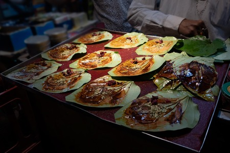Paan, meaning leaf, is a preparation combining betel leaf with areca nut widely consumed in India. It is chewed for its stimulant and psychoactive effects. It is a very popular Indian food item.