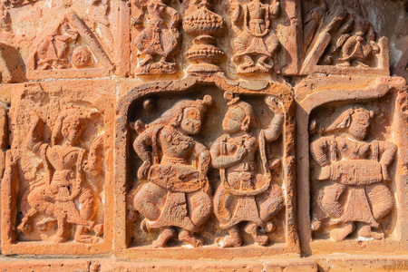 Famous terracotta (fired clay of a brownish-red colour, used as ornamental building material) relief artworks at Madanmohan Temple, Bishnupur, West Bengal, India. UNESCO heritage site of India.