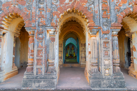 Deities at Radhashyam Temple - made of terracotta (fired clay of a brownish-red colour, used as ornamental building material) artworks at Bishnupur, West Bengal, India. Popular UNESCO heritage site. Stock Photo