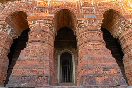 Famous terracotta (fired clay of a brownish-red colour, used as ornamental building material) arches at Radhashyam Temple, Bishnupur, West Bengal, India. It is popular UNESCO heritage site of India.