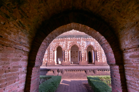 Famous terracotta (fired clay of a brownish-red colour, used as ornamental building material) artworks at Lalji Temple, Bishnupur, West Bengal, India. It is popular UNESCO heritage site of India. Фото со стока