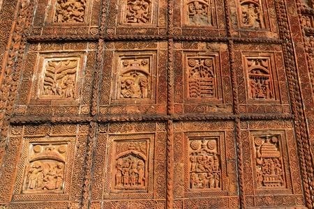 Famous terracotta (fired clay of a brownish-red colour, used as ornamental building material) motif artworks at Madanmohan Temple, Bishnupur, West Bengal, India. UNESCO heritage site of India. Фото со стока