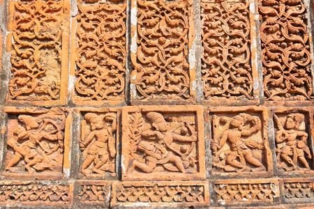 Famous terracotta (fired clay of a brownish-red colour, used as ornamental building material) artworks at Madanmohan Temple, Bishnupur, West Bengal, India. It is popular UNESCO heritage site of India. Banco de Imagens