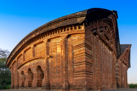 Radhashyam Temple - made of terracotta (fired clay of a brownish-red colour, used as ornamental building material) artworks at Bishnupur, West Bengal, India. Popular UNESCO heritage site of India.