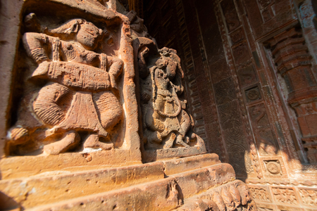 Famous terracotta (fired clay of a brownish-red colour, used as ornamental building material) artworks at Madanmohan Temple, Bishnupur, West Bengal, India. It is popular UNESCO heritage site of India. Фото со стока