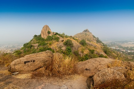 Joychandi Pahar - mountain - is a hill which is a popular tourist attraction in the Indian state of West Bengal in Purulia district. Image of the top of the hill in early morning. 스톡 콘텐츠