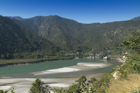 Dhari Devi temple,on the banks of the Alaknanda River, Garhwal Region of Uttarakhand, India. The temple is home to Hindu goddess Dhari and Goddess Kali , in one body. 스톡 콘텐츠