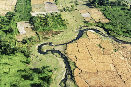 Aerial view of Bangladesh ,taken from aeroplane. The green rural agriculture fields of Bangaladesh with turns of Padma river seen from the sky.