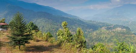 Beautiful scenic panoramic image of India Bhutan border at Jhalong , Dooars - West Bengal , India