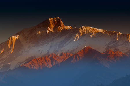 Sunrise on Chaukhamba , a mountain massif in the Gangotri Group of the Garhwal Himalaya. It lies at the head of the Gangotri Glacier at Uttarakhand, India.