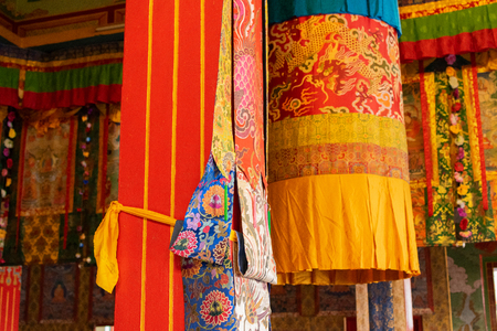 Buddhist thangka - a Tibetan Buddhist painting on cotton, or silk applique - in a monastery in Ralong, Sikkim, India 스톡 콘텐츠