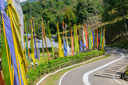 Beautiful way to Ralong Monastery at Ralong, colourful Buddist prayer religious flags waving on the side of road . Ralong is full of scenic natural vista in background, in Sikkim, India. 스톡 콘텐츠