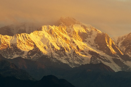 Sunset on Chaukhamba peaks, a mountain massif in the Gangotri Group of the Garhwal Himalaya. It lies at the head of the Gangotri Glacier at Uttarakhand, India. 스톡 콘텐츠