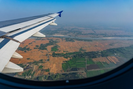 Aerial view of Bangladesh ,taken from aeroplane. The green rural agriculture fields of Bangaladesh seen from the sky. 스톡 콘텐츠