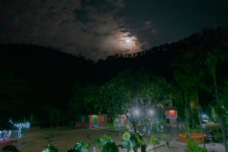 Clouds covering the moon partly over jhalong village at night, Image shot at Dooars - North of West Bengal, India 스톡 콘텐츠