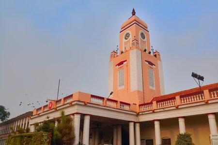 MYSORE, KARNATAKA, INDIA - NOVEMBER 25TH, 2018 : The clock tower at railway station of Mysore, officially Mysuru, view in the morning.