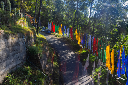 Colurful Buddhist Prayer flags at Namchi in Sikkim, India. Sikkim is full of vibrant colours - attractive for tourism in India. 에디토리얼