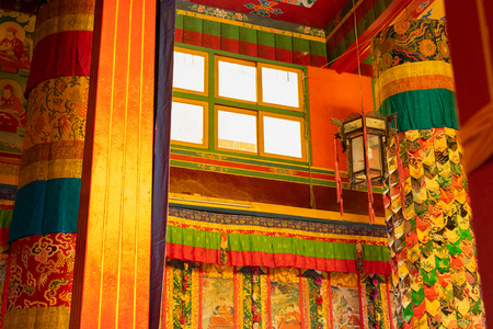Colourful interior decoration of a Buddhist monastery in Ralong, Sikkim, India