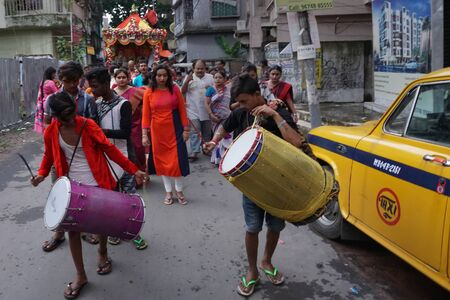 HOWRAH, WEST BENGAL , INDIA - JULY 22TH 2018 : Drummers playing drums at Rath jatra festival, while devoteed dragging Rath, chariot, of God Jagannath, Balaram and Goddess Suvadra, on the street.