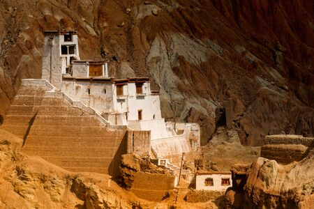 Ruins and Basgo Monastery surrounded with stones and rocks of Himalayan mountains , Leh, Ladakh, union territory, India. Play of light and shadow on backgound mountains.