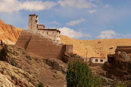 Ruins and Basgo Monastery surrounded with stones and rocks of Himalayan mountains , Leh, Ladakh, union territory, India. Blue sky background. Stock Photo