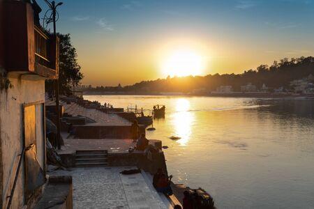 Sunset near Ram jhula bridge of Rishikesh, famous for association with Hindu mythology God Ram, Uttarakhand, India
