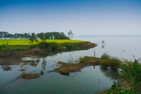 Backwaters of Kerala, India - The Kerala backwaters are a network of brackish lagoons and lakes lying parallel to the Arabian Sea coast of Kerala state in southern India. Blue sky background.