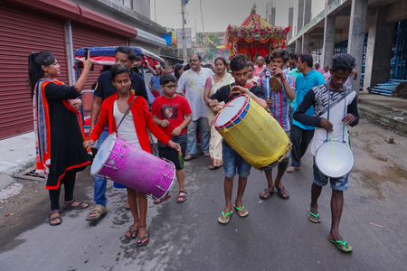 Howrah, West Bengal , India - July 22nd 2018 : Drummers playing drums at Rath jatra festival, while devotees dragging Rath, chariot, of God Jagannath, Balaram and Goddess Suvadra, on the street.