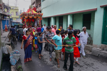Howrah, West Bengal, India - July 22nd 2018 : Hindu devotees dragging Rath, chariot, of God Jagannath, Balaram and Goddess Suvadra as ritual by Holy rope, on the street. Famous Rath jatra festival. Editorial