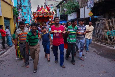 Howrah, West Bengal, India - July 22nd 2018 : Hindu young devotees dragging Rath, chariot, of God Jagannath, Balaram and Goddess Suvadra as ritual by Holy rope, Famous Rath jatra festival. Editorial