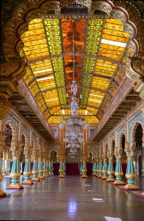 Mysore, Karnataka, India - November 25th 2018 : Beautiful decorated interior ceiling of the Private Durbar Hall, called Diwan-E-Khas, inside the royal Mysore Palace. Gold used on gilded ceiling. Editöryel