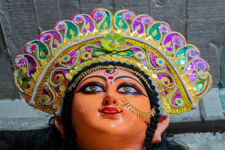 Kolkata, West Bengal, India - 7th October 2018 : Clay idol face of Goddess Durga, under preparation for Editorial