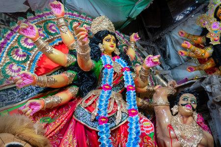 Kolkata, West Bengal, India - 7th October 2018 : Clay idol of Goddess Durga and Asura under preparation, Editorial